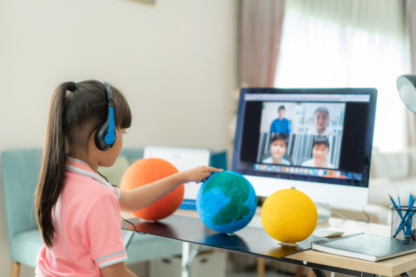 Asian girl student live learning video conference with teacher and other classmates giving presentation, showing solar model project, Homeschooling and distance learning ,online ,education and internet.